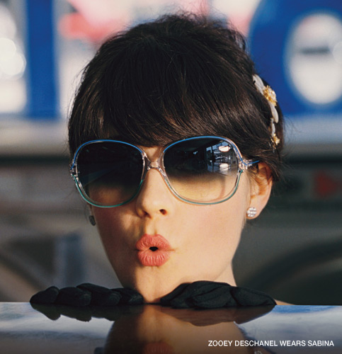 "the trademark lips stamped on the ""zooey"" glasses"